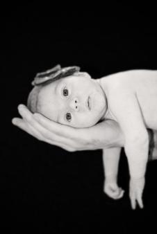 Olesya Laying On Daddys Hand